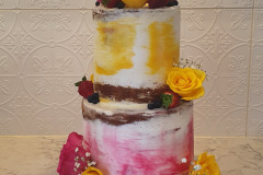 2 tier coloured birthday buttercream cake with flowers from $350
