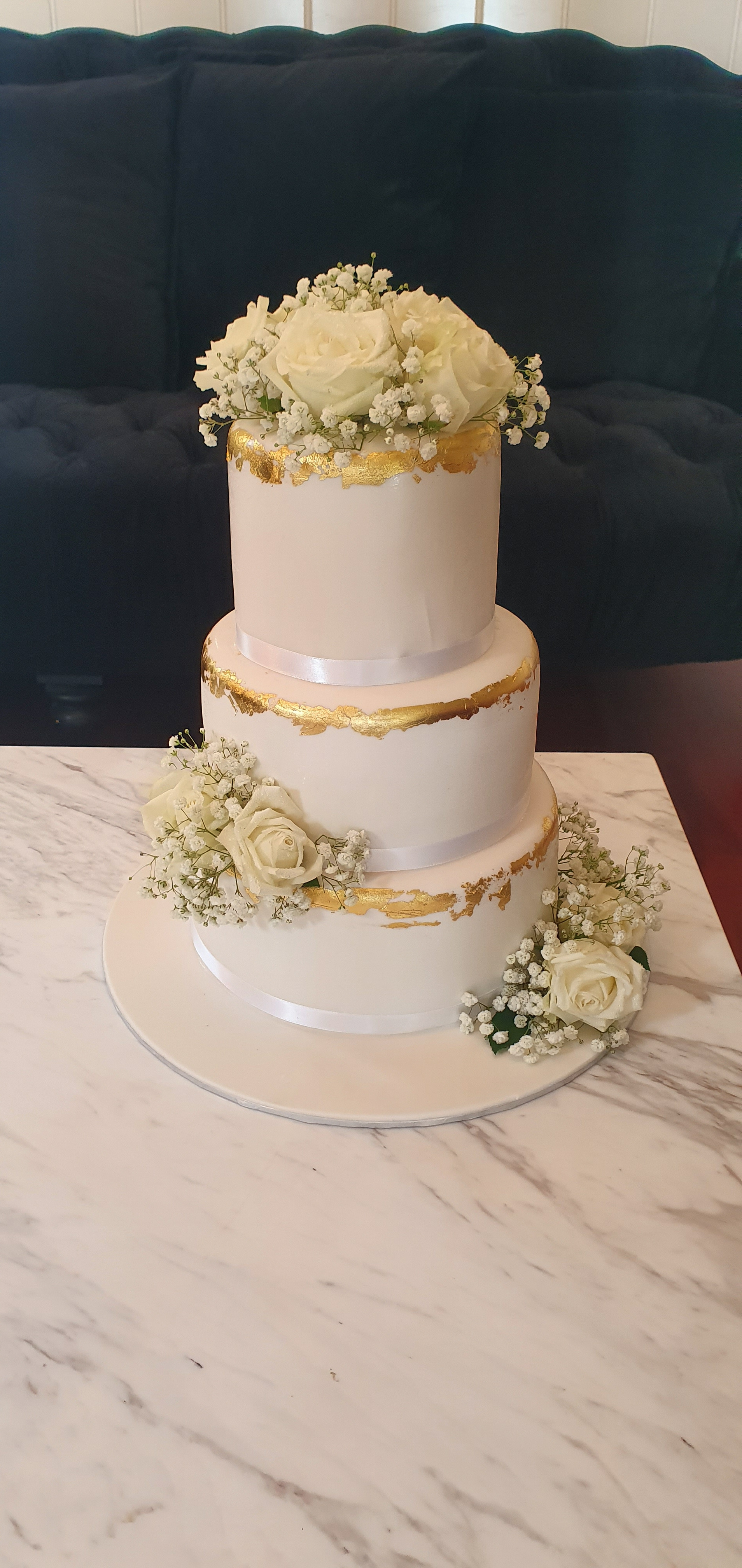 3 tier white fondant cake with gold accent from $650