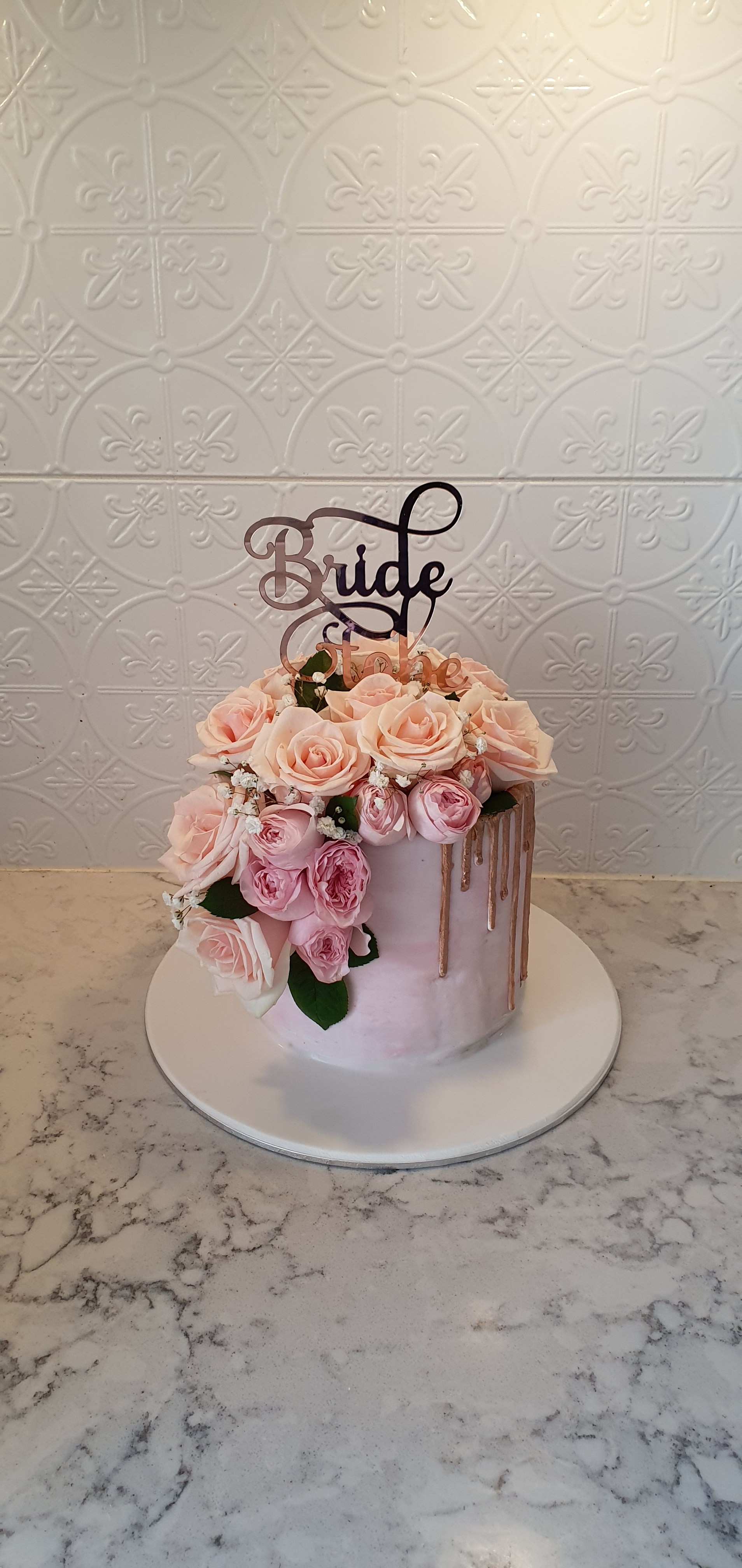 1 tier bridal shower/wedding cake with gold drips and roses