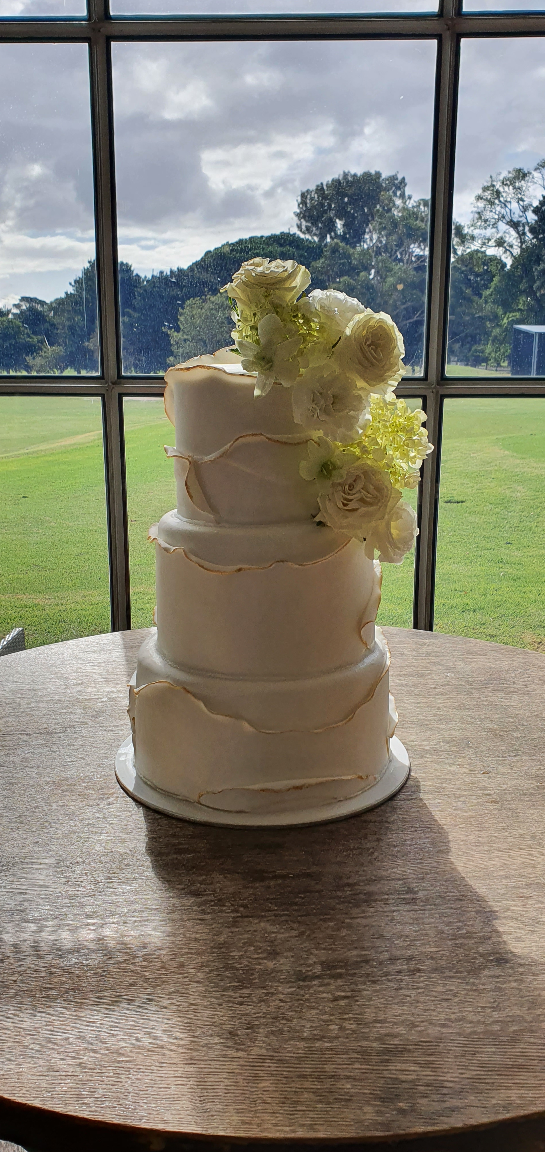 Ruffle fondant wedding cake with gold edge detailing from $650