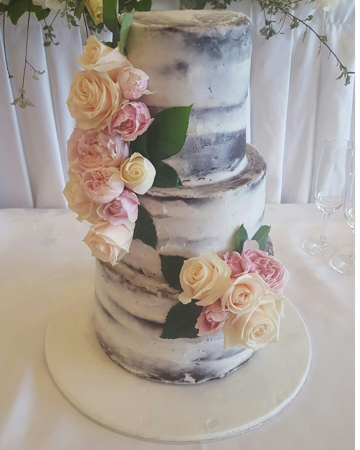 Semi naked cake with fresh roses from $580