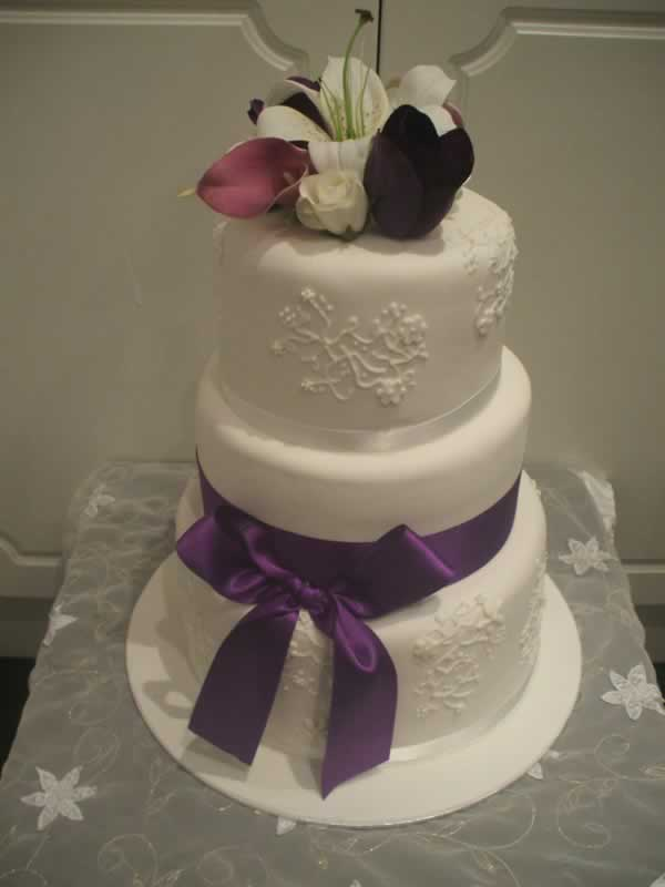 Piped Purple Bow Wedding Cake From $550
