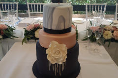 Black ,Marble and Rose Gold Wedding Cake from $700