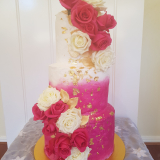 Painted buttercream wedding cake with fresh roses and gold leaf $570