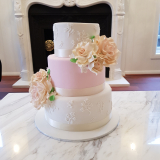 Classic wedding cake with piped detail and sugar roses